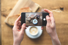 Woman Making Photo Of Her Brea...
