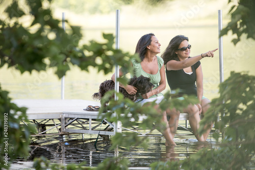 Fotografie, Obraz  Mother and Daughter Laughing vacationing at the Lake