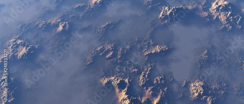Fotografie, Obraz  Aerial of rough rocky terrain in mist.