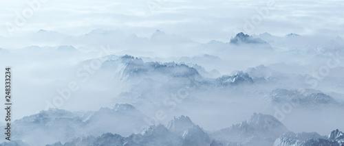 Aerial of rough steep snowy mountains in fog. Wallpaper Mural