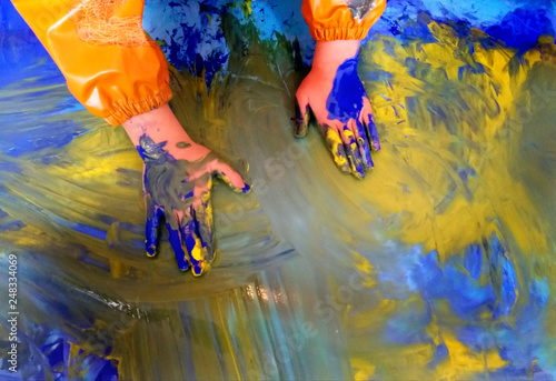 Canvas Print closeup of children hands painting during a school activity - learning by doing,