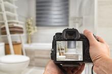 Hands Holding DSLR Capturing Interior Of A Modern Bathroom
