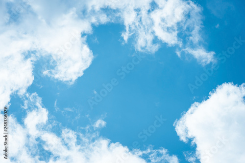 Cumulus humilis clouds in the blue sky, view from below - 248336029