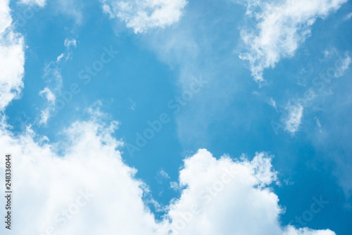 Photographie  Cumulus humilis clouds in the blue sky, view from below