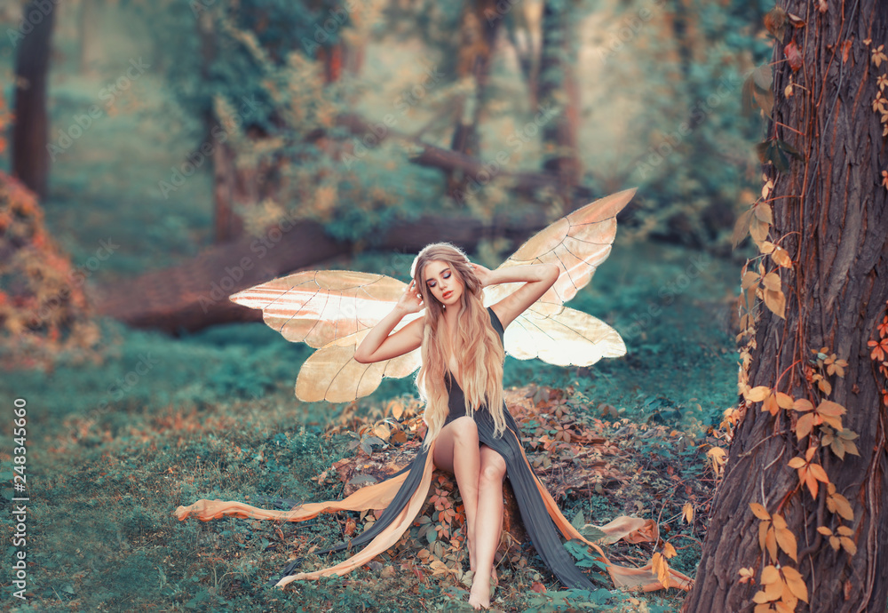 Fototapeta charming fairy woke up in forest, sweetly smacks after sleeping