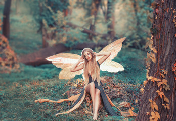 charming fairy woke up in forest, sweetly smacks after sleeping
