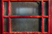 Close Up Of A Telephone Box Window