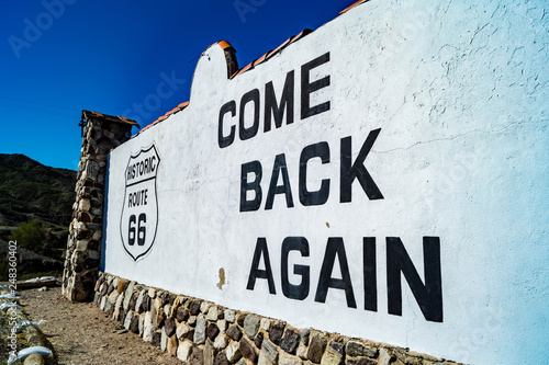 Photo  Route 66 come back again sign near Needles, California