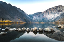 Long Exposure Sunrise Photo Of Convict Lake, An Alpine Lake In The Sierra Nevada Mountains Of California, With Alpenglow On The Mountain Peak On A Fall Morning