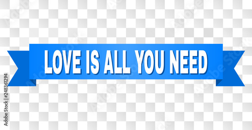 Photo  LOVE IS ALL YOU NEED text on a ribbon