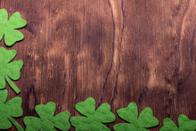 Green Clover Leaf On Wooden Ba...
