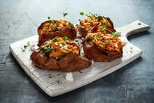 Roast Sweet Potato Stuffed With Feta Cheese And Kale. Healthy Food
