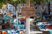 Handmade In Crete Sign On A Board Attached To A Pole.