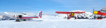 Monte Pora, Bergamo, Italy. A Single Engined, Light Aircrafts Parked On A Snow Covered Plateau. Red And UK Flag Colors As Livery
