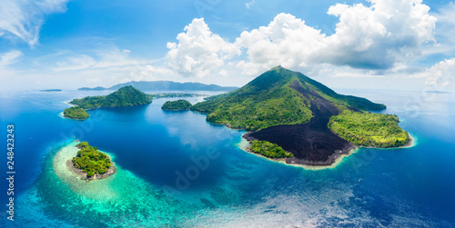 Aerial view Banda Islands Moluccas archipelago Indonesia, Pulau Gunung Api, lava flows, coral reef white sand beach. Top travel tourist destination, best diving snorkeling.