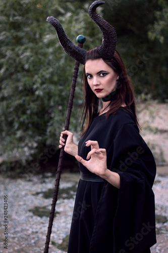 Photo Wicked Maleficent without wings with a staff
