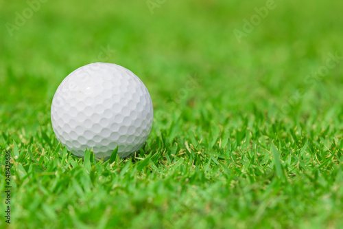 Deurstickers Golf Close up of Golf ball on the green grass