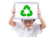 Little girl shows recycle symbol on the tablet