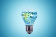 Light Bulb With World Globe An...