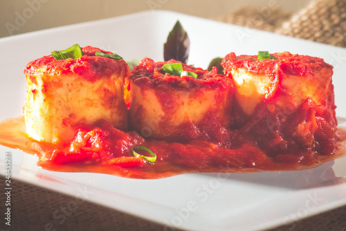Fotografie, Obraz  Traditional Italian Rondelli pasta with tomato sauceon rustic background