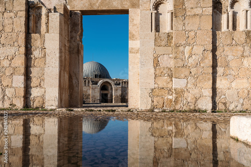 Ancient architecture with reflection on the water at Citadel in Amman, Jordan Wallpaper Mural