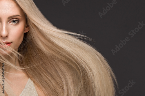 Beautiful blond girl in move with a perfectly smooth hair, and classic make-up Poster Mural XXL