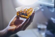Passenger Enjoying Snack In Airplane