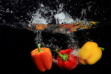 Pepper Falling Into Water