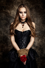 Gothic Woman Black Dress, Flower Rose In Hands Tied By Rope, Fashion Model Beauty Portrait