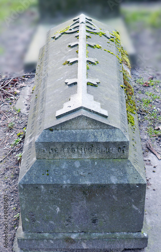 Stone sarcophagues/grave with metal cross  in Aberdeen churchyard Canvas Print