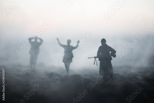 Obraz War Concept. Military silhouettes fighting scene on war fog sky background, World War Soldiers Silhouettes Below Cloudy Skyline At night. Attack scene. Armored vehicles. Tanks battle. Decoration - fototapety do salonu
