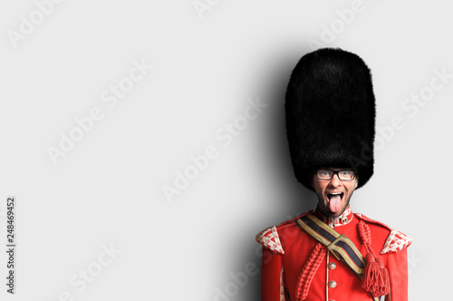 Foto  Young man in the costume of the Royal guards of Britain