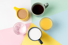 Coffee Tea And Other Drinks In Colorful Cups On A Multicolored Background, Top View