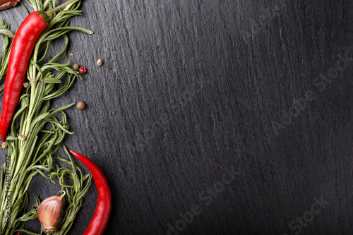 In de dag Hot chili peppers red pepper on a black background place for text