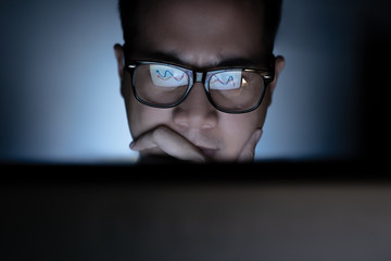 Focused and serious looking man working and thinking hard on computer