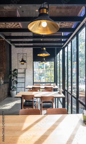 Carta da parati Table and chair set in modern cafe minimalistic interior design with big window