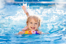 Child Learning To Swim. Kids I...
