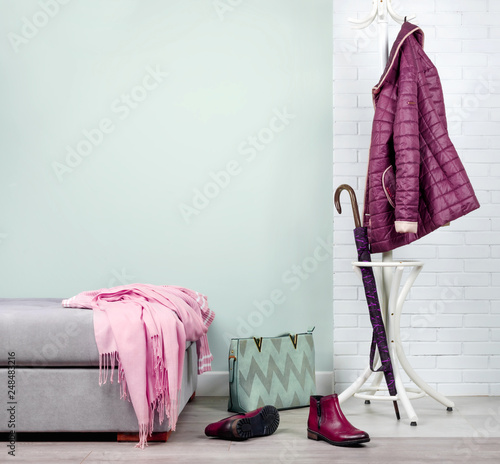 Leinwand Poster Stylish hallway interior with with clothes and shoes