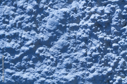 Fotografie, Obraz  Texture of blue stone wall with rough stucco surface