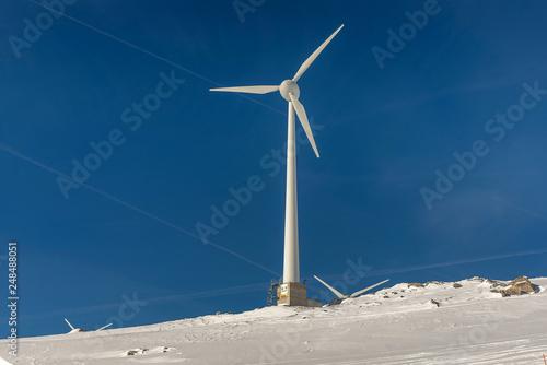Fotografie, Obraz  Wind turbine and snow in the Alps, Switzerland
