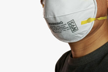 Man Wearing Facial  N95 Filter Face Mask,  Ecology, Air Pollution, Environmental ,dust And Smoke Welding Protection With Small