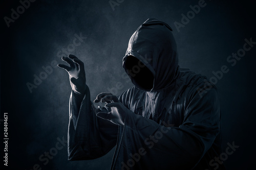 Photographie Scary figure in hooded cloak