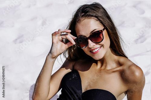 ced120e9f016b Fashion beautiful cheerful happy woman in sunglasses and bikini on the  beach in summer.Face close up.