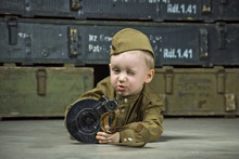 The Boy Is Dressed In Military...