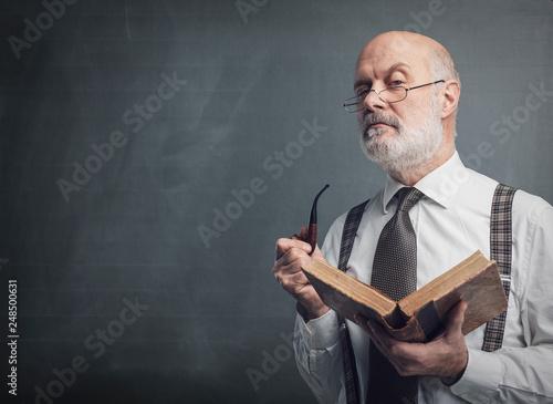 Senior academic professor reading and smoking a pipe Wallpaper Mural