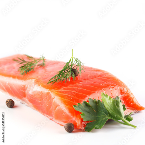 Poster Fish salmon with herbs and spices on white background