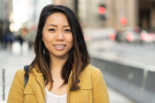 Young Asian woman in city smile happy face portrait Canvas Print