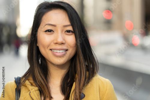 Carta da parati Young Asian woman in city smile happy face portrait