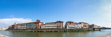 Panoramic View Of The Colorful Houses On The Banks Of The Arno River From The Other Shore, Pisa