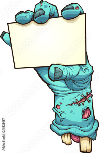 Fotografiet Cartoon severed zombie hand holding a blank card